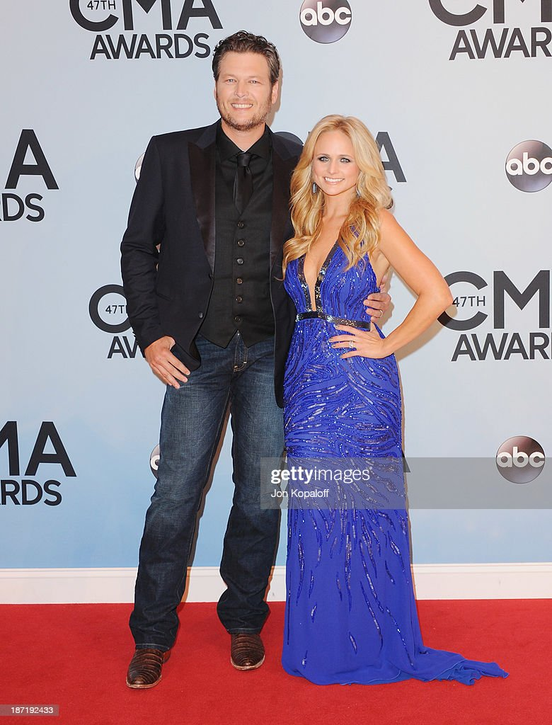 Singers Blake Shelton and wife Miranda Lambert attend the 47th annual CMA Awards at the Bridgestone Arena on November 6, 2013 in Nashville, Tennessee.