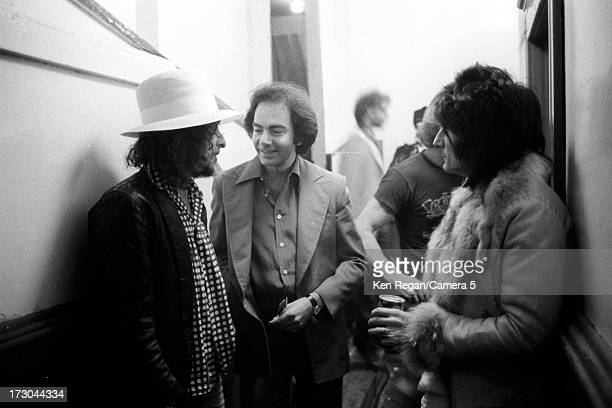 Singers Bob Dylan Neil Diamond and Ron Wood of the Rolling Stones are photographed backstage of The Last Waltz concert on November 25 1976 in San...