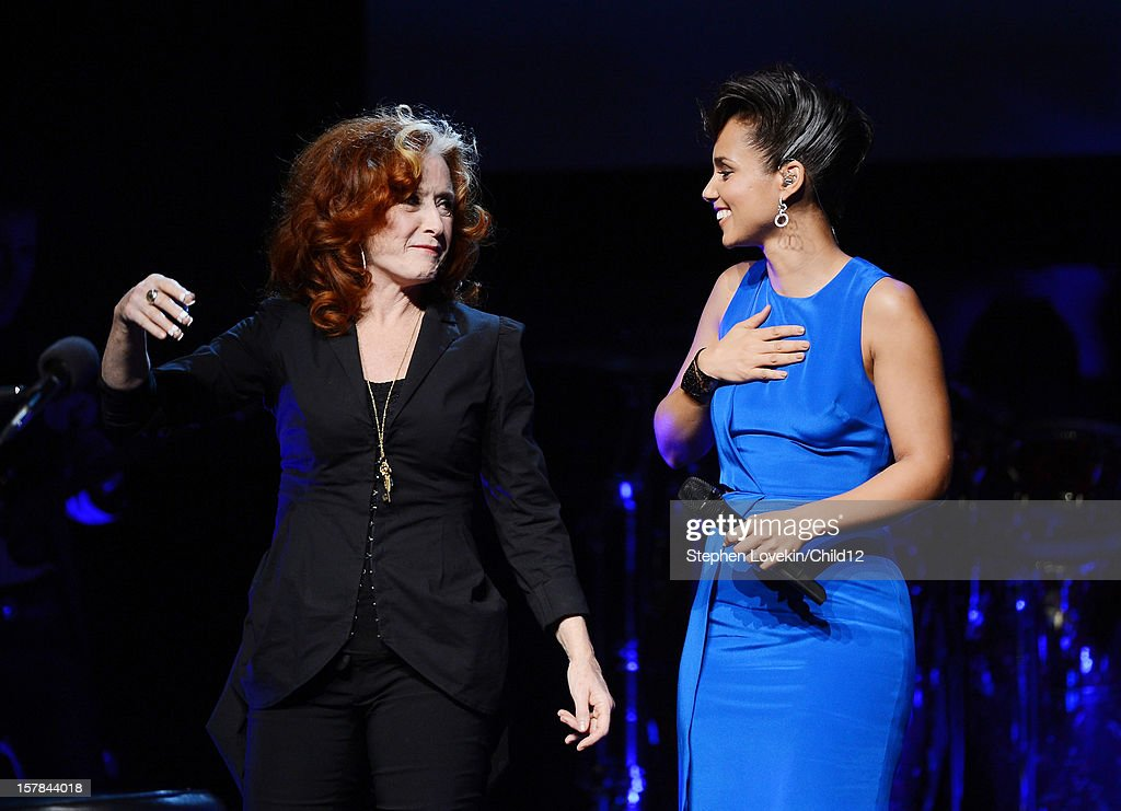 Singers <a gi-track='captionPersonalityLinkClicked' href=/galleries/search?phrase=Bonnie+Raitt&family=editorial&specificpeople=213312 ng-click='$event.stopPropagation()'>Bonnie Raitt</a> and <a gi-track='captionPersonalityLinkClicked' href=/galleries/search?phrase=Alicia+Keys&family=editorial&specificpeople=169877 ng-click='$event.stopPropagation()'>Alicia Keys</a> speak on stage during Black Ball Redux at The Apollo Theater on December 6, 2012 in New York City.