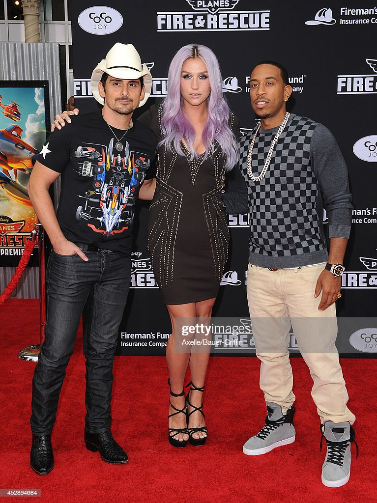 Singers <a gi-track='captionPersonalityLinkClicked' href=/galleries/search?phrase=Brad+Paisley&family=editorial&specificpeople=206616 ng-click='$event.stopPropagation()'>Brad Paisley</a> and Kesha and actor/rapper <a gi-track='captionPersonalityLinkClicked' href=/galleries/search?phrase=Ludacris&family=editorial&specificpeople=203034 ng-click='$event.stopPropagation()'>Ludacris</a> attend the premiere of 'Planes: Fire & Rescue' at the El Capitan Theatre on July 15, 2014 in Hollywood, California.
