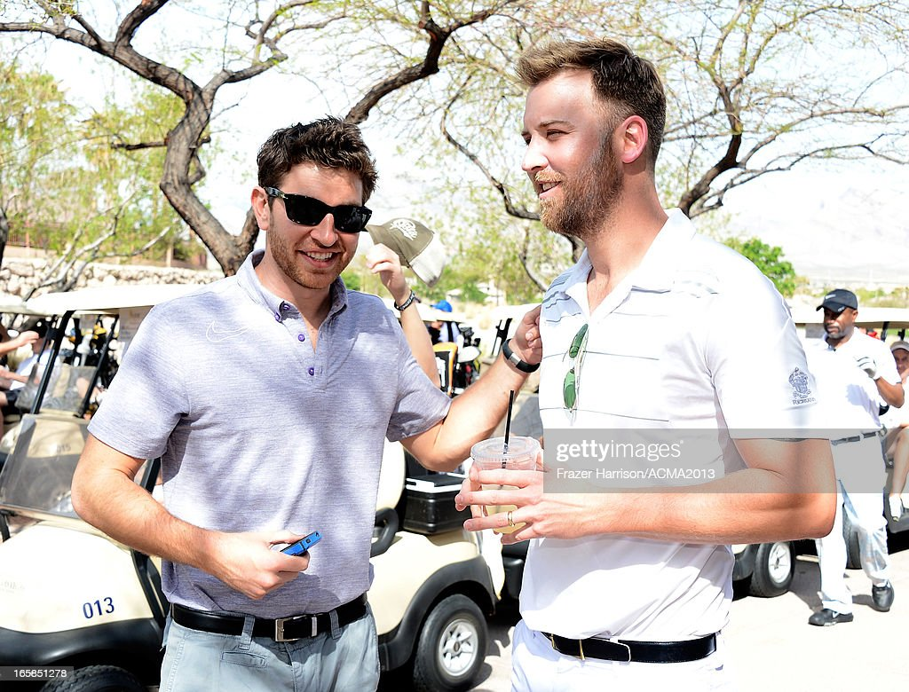 Singers Brett Eldredge (L) and Charles Kelley of Lady Antebellum attend the ACM Lifting Lives Celebrity Golf Classic during the 48th Annual Academy of Country Music Awards at TPC Summerlin on April 6, 2013 in Las Vegas, Nevada.