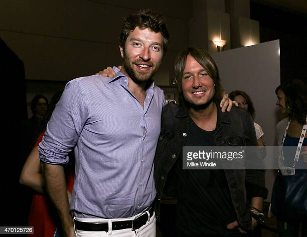Singers Brett Eldredge and Keith Urban attend the Red Carpet Radio presented by Westwood One Radio during the 50th Academy Of Country Music Awards at...