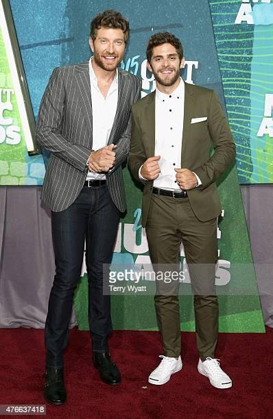 Singers Brett Eldredge and Thomas Rhett attend the 2015 CMT Music awards at the Bridgestone Arena on June 10 2015 in Nashville Tennessee