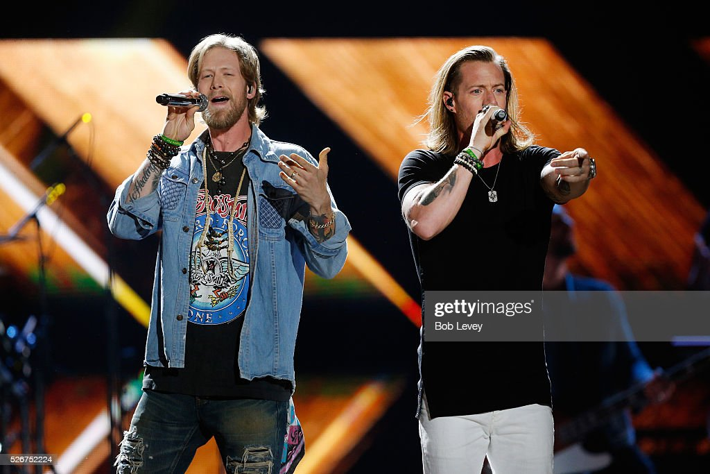 Singers Brian Kelley (L) and Tyler Hubbard of Florida Georgia Line perform onstage during the 2016 iHeartCountry Festival at The Frank Erwin Center on April 30, 2016 in Austin, Texas.