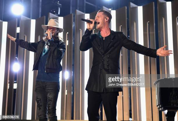 Singers Brian Kelley and Tyler Hubbard of Florida Georgia Line perform onstage during the 2017 Billboard Music Awards at TMobile Arena on May 21 2017...