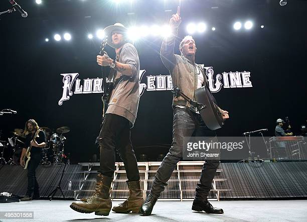 Singers Brian Kelley left and Tyler Hubbard of Florida Georgia Line perform at the 10th anniversary 'Miles Music' concert on November 1 2015 in...