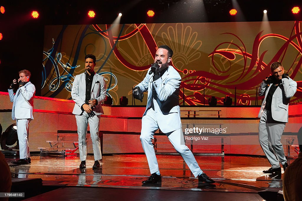 Singers Brian Littrell, Kevin Richardson, AJ McLean and Nick Carter of Backstreet Boys performs at Backstreet Boys In Concert at Gibson Amphitheatre on September 4, 2013 in Universal City, California.