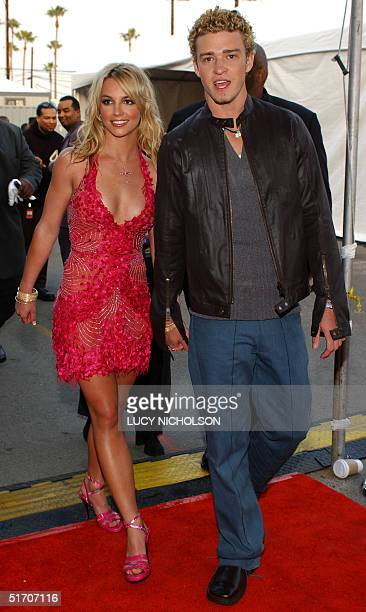 US singers Britney Spears and her boyfriend Justin Timberlake of the group N*SYNC arrive at the 29th Annual American Music Awards in Los Angeles CA...