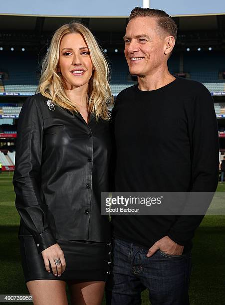 Singers Bryan Adams and Ellie Goulding pose during a 2015 AFL Grand Final Entertainment Media Opportunity at the Melbourne Cricket Ground on October...
