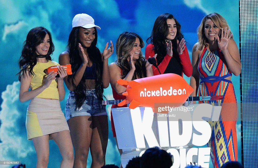 Singers Camila Cabello, Normani Kordei, Ally Brooke, Lauren Jauregui and Dinah Jane of Fifth Harmony accept the Favorite Music Group Award onstage during Nickelodeon's 2016 Kids' Choice Awards at The Forum on March 12, 2016 in Inglewood, California.
