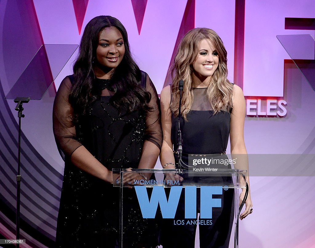 Singers Candice Glover (L) and Angie Miller speak onstage during Women In Film's 2013 Crystal + Lucy Awards at The Beverly Hilton Hotel on June 12, 2013 in Beverly Hills, California.