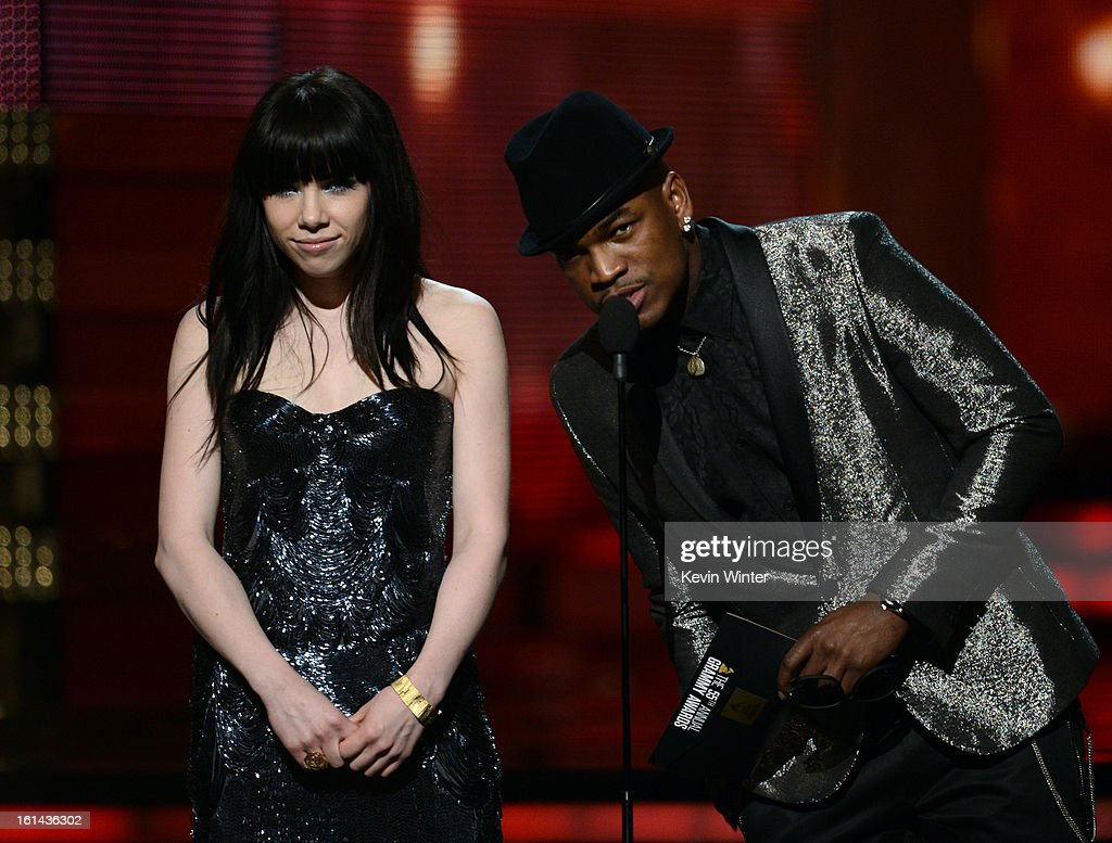 Singers Carly Rae Jepsen (L) and Ne-Yo speak onstage during the 55th Annual GRAMMY Awards at STAPLES Center on February 10, 2013 in Los Angeles, California.