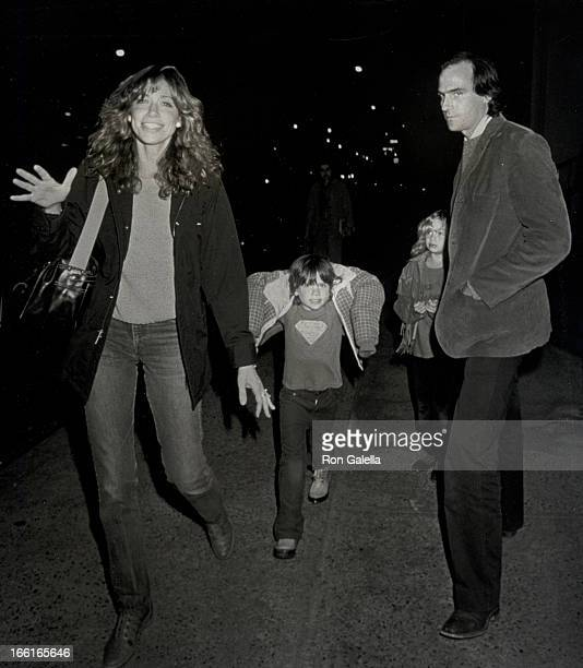 Singers Carly Simon James Taylor son Benjamin Taylor and daughter Sarah Taylor being photographed on November 4 1981 outside their apartment in New...