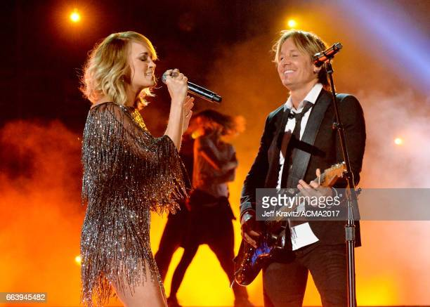 Singers Carrie Underwood and Keith Urban perform onstage at the 52nd Academy Of Country Music Awards at TMobile Arena on April 2 2017 in Las Vegas...