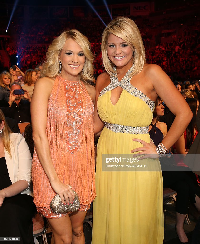 Singers Carrie Underwood (L) and Lauren Alaina attend the 2012 American Country Awards at the Mandalay Bay Events Center on December 10, 2012 in Las Vegas, Nevada.