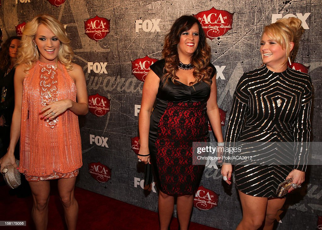 Singers Carrie Underwood, April Pace and Miranda Lambert arrive at the 2012 American Country Awards at the Mandalay Bay Events Center on December 10, 2012 in Las Vegas, Nevada.