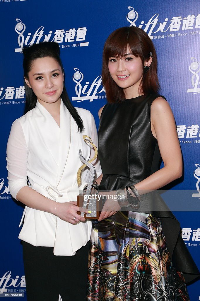 Singers Charlene Choi (R) and Gillian Chung of Twins attend the 2013 IFPI Hong Kong Top Sales Music Awards at Star Hall on February 26, 2013 in Hong Kong.
