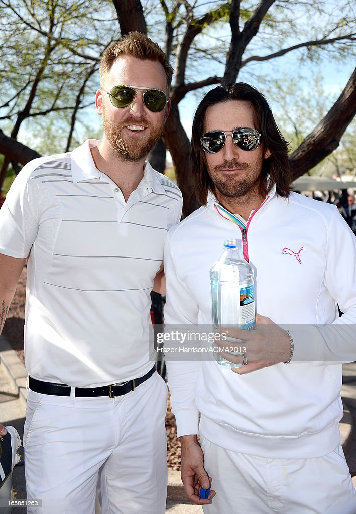 Singers Charles Kelley of Lady Antebellum (L) and Jake Owen attend the ACM Lifting Lives Celebrity Golf Classic during the 48th Annual Academy of Country Music Awards at TPC Summerlin on April 6, 2013 in Las Vegas, Nevada.