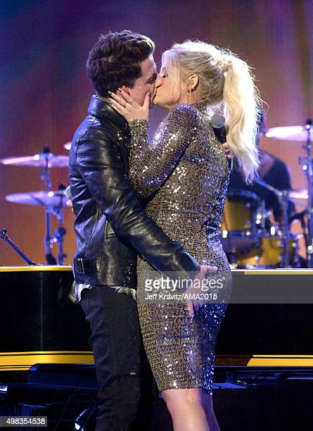 Singers Charlie Puth and Meghan Trainor kiss onstage during the 2015 American Music Awards at Microsoft Theater on November 22 2015 in Los Angeles...