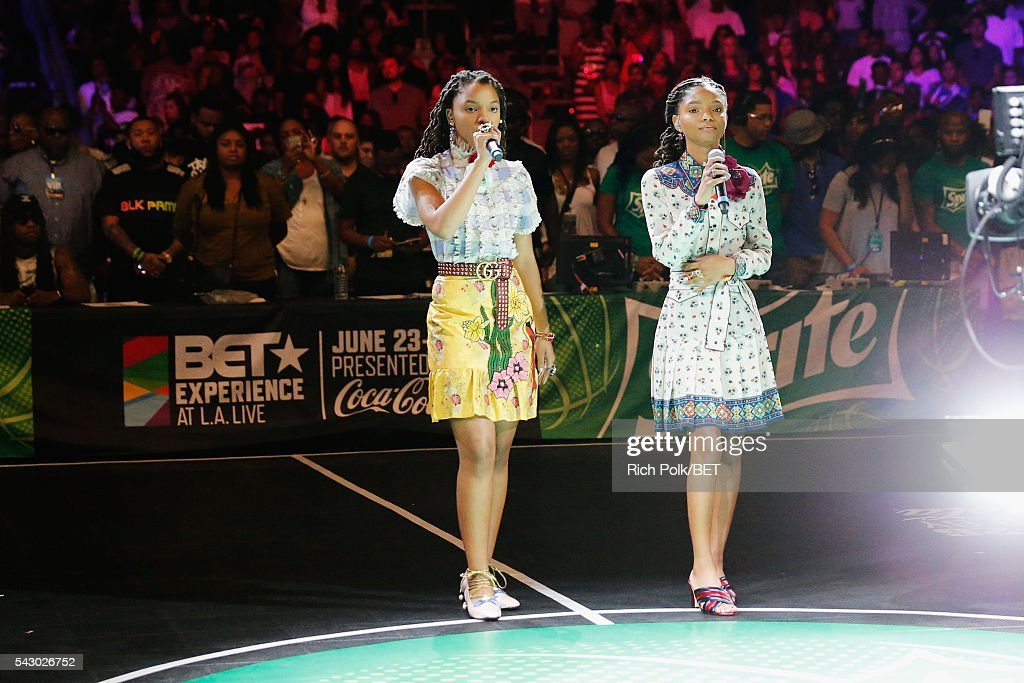 Singers Chloe Bailey (L) and Halle Bailey of Chloe x Halle perform the national anthem during the celebrity basketball game presented by Sprite during the 2016 BET Experience on June 25, 2016 in Los Angeles, California.