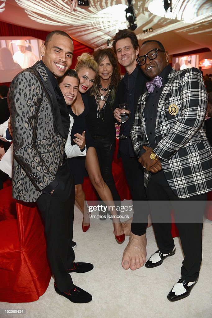 Singers Chris Brown and Asher Monroe, Chairman and Founder of Neuro Diana Jenkins, singer Steven Tyler, actor Jim Carrey and tv personality Randy Jackson attend the 21st Annual Elton John AIDS Foundation Academy Awards Viewing Party at West Hollywood Park on February 24, 2013 in West Hollywood, California.