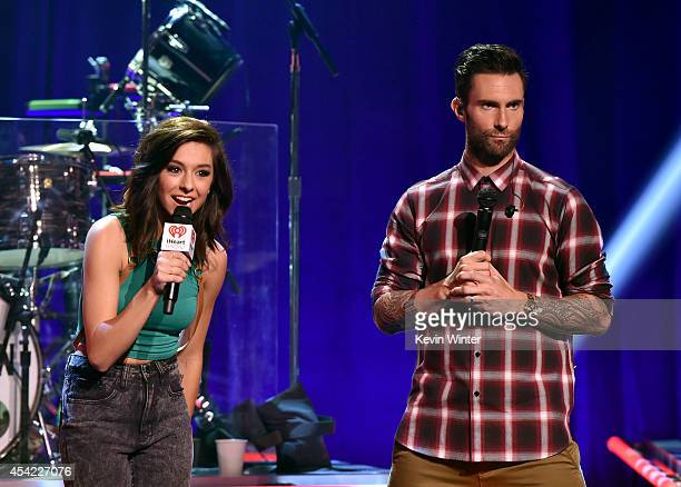 Singers Christina Grimmie and Adam Levine speak onstage druing the iHeartRadio Album Release Party with Maroon 5 LIVE on the CW at iHeartRadio...