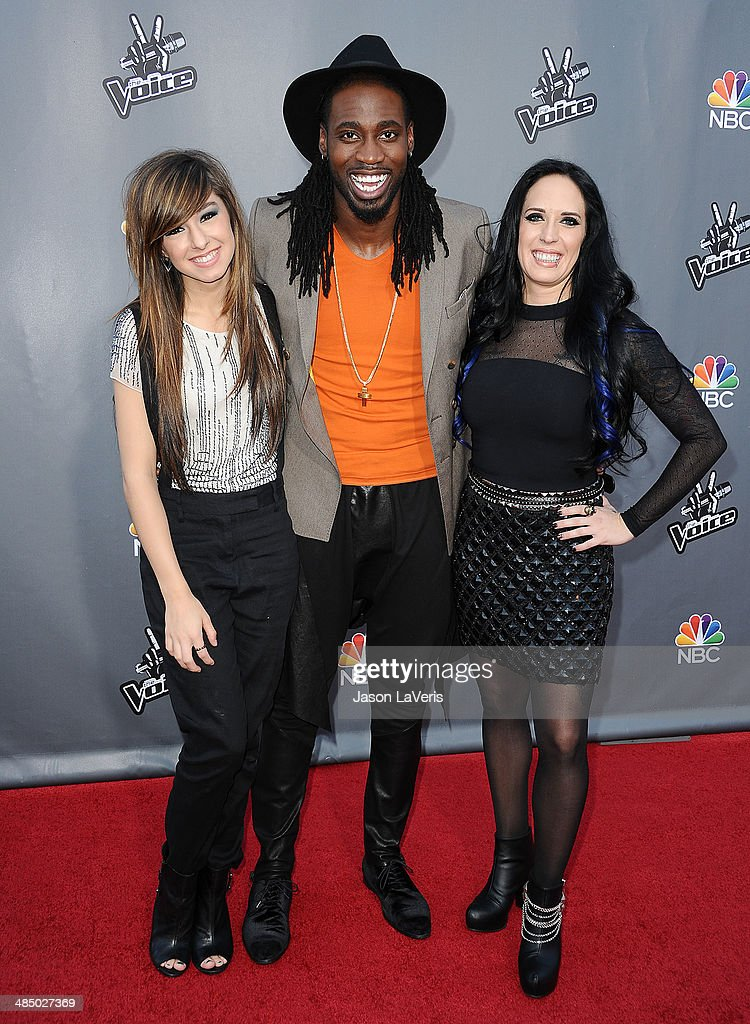Singers <a gi-track='captionPersonalityLinkClicked' href=/galleries/search?phrase=Christina+Grimmie&family=editorial&specificpeople=7293581 ng-click='$event.stopPropagation()'>Christina Grimmie</a>, <a gi-track='captionPersonalityLinkClicked' href=/galleries/search?phrase=Delvin+Choice&family=editorial&specificpeople=12505219 ng-click='$event.stopPropagation()'>Delvin Choice</a> and <a gi-track='captionPersonalityLinkClicked' href=/galleries/search?phrase=Kat+Perkins&family=editorial&specificpeople=12537553 ng-click='$event.stopPropagation()'>Kat Perkins</a> attend 'The Voice' season 6 top 12 red carpet event at Universal CityWalk on April 15, 2014 in Universal City, California.