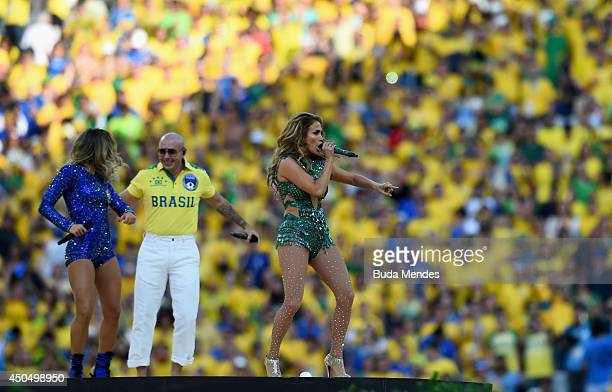 Singers Claudia Leitte Pitbull and Jennifer Lopez perform during the Opening Ceremony of the 2014 FIFA World Cup Brazil prior to the Group A match...