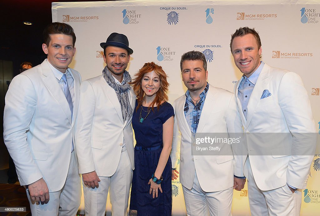 Singer's Clifton Murray, Victor Micallef and violinist Lindsey Stirling and singer's Remigio Pereira and Fraser Walters arrive at Cirque du Soleil's 2nd annual 'One Night for One Drop' at Aureole Las Vegas at the Mandalay Bay Resort and Casino on March 21, 2014 in Las Vegas, Nevada.