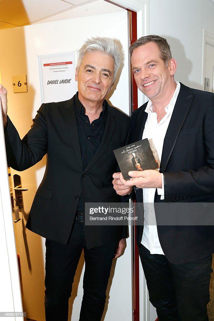 Singers Daniel Lavoie who presents his album 'La Licorne captive' and Garou attend the 'Vivement Dimanche' French TV Show at Pavillon Gabriel on April 9, 2014 in Paris, France.