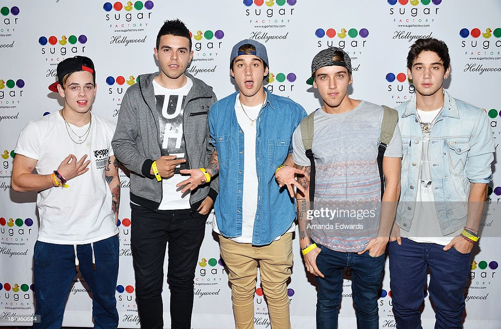 Singers Daniel Sahyounie, James Yammouni, Luke Brooks, Beau Brooks and Jai Brooks of the band The Janoskians arrive at the grand opening of Sugar Factory Hollywood at Sugar Factory on November 13, 2013 in Hollywood, California.