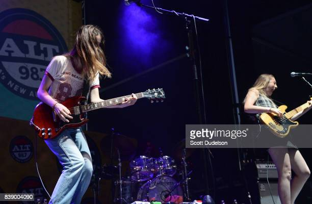 Singers Danielle Haim and Este Haim of the band HAIM performs onstage at Queen Mary Events Park on August 19 2017 in Long Beach California