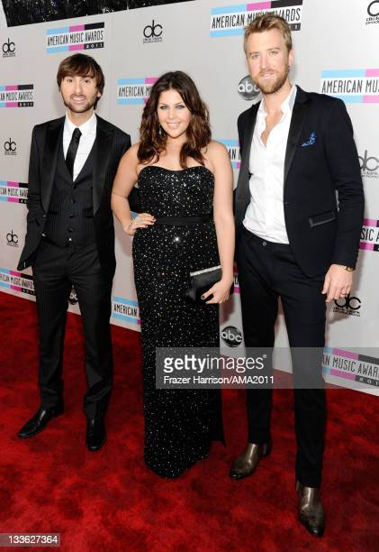 Singers Dave Haywood Hillary Scott and Charles Kelley of Lady Antebellum arrive at the 2011 American Music Awards held at Nokia Theatre LA LIVE on...