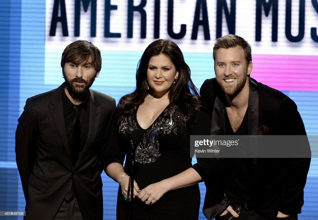Singers (L-R) <a gi-track='captionPersonalityLinkClicked' href=/galleries/search?phrase=Dave+Haywood&family=editorial&specificpeople=4620526 ng-click='$event.stopPropagation()'>Dave Haywood</a>, Hillary Scott and <a gi-track='captionPersonalityLinkClicked' href=/galleries/search?phrase=Charles+Kelley&family=editorial&specificpeople=3935435 ng-click='$event.stopPropagation()'>Charles Kelley</a> of Lady Antebellum speak onstage during the 2013 American Music Awards at Nokia Theatre L.A. Live on November 24, 2013 in Los Angeles, California.