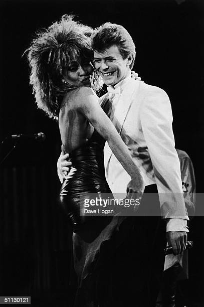 Singers David Bowie and Tina Turner perform on stage at the NEC Birmingham