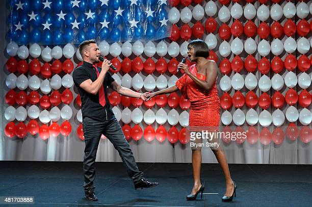 Singers David Hernandez and Eunice Love perform during the DIRECTV and Operation Gratitude day of service at the fifth annual DIRECTV Dealer...
