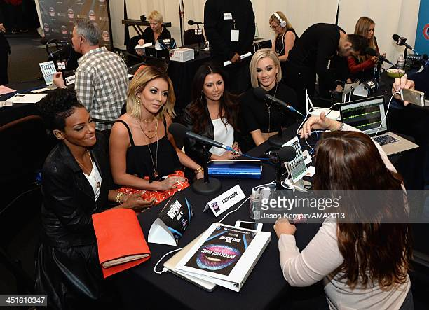 Singers Dawn Richards Aubrey O'Day Andrea Fimbres and Shannon Bex of Danity Kane attend the 2013 American Music Awards Radio Room at Nokia Theatre LA...