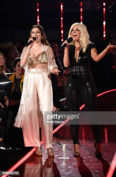 Singers Daya and Bebe Rexha speak onstage at the 2017 iHeartRadio Music Awards which broadcast live on Turner's TBS TNT and truTV at The Forum on...