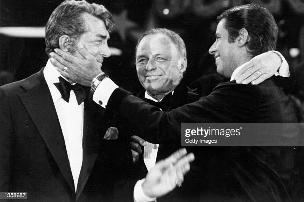 Singers Dean Martin Frank Sinatra and Jerry Lewis perform during the 1976 telecast of The Jerry Lewis MDA Telethon in Los Angeles California This...