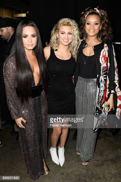 Singers Demi Lovato Tori Kelly and Andra Day attend The 59th GRAMMY Awards at STAPLES Center on February 12 2017 in Los Angeles California