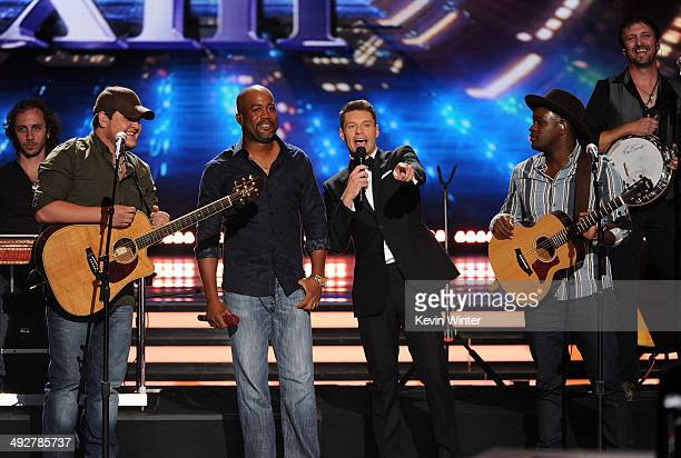 Singers Dexter Roberts Darius Rucker host Ryan Seacrest and singer CJ Roberts perform onstage during Fox's 'American Idol' XIII Finale at Nokia...