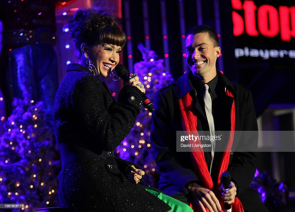 Singers Diana DeGarmo (L) and Ace Young perform on stage at Associated Television International's 2012 Hollywood Christmas Parade Concert at Universal CityWalk's 5 Towers on November 20, 2012 in Universal City, California.