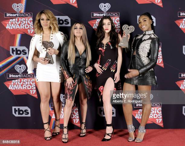 Singers Dinah Jane Ally Brooke Lauren Jauregui and Normani Kordei of Fifth Harmony who accepted the award for Best Fan Army pose in the press room at...