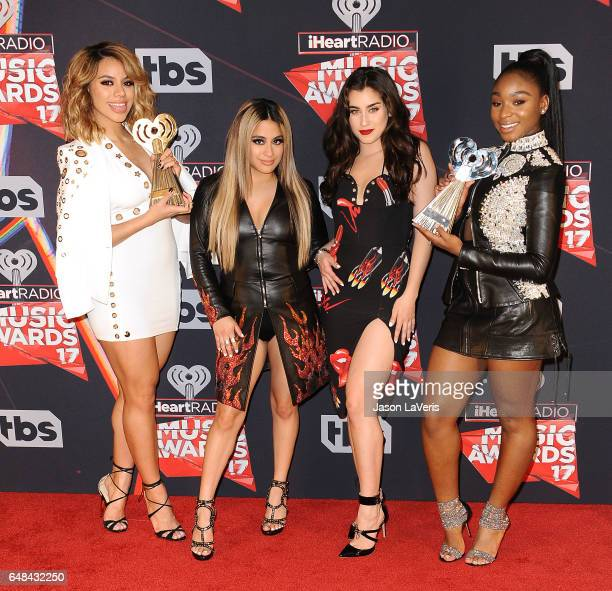 Singers Dinah Jane Lauren Jauregui Ally Brooke and Normani Kordei of Fifth Harmony pose in the press room at the 2017 iHeartRadio Music Awards at The...
