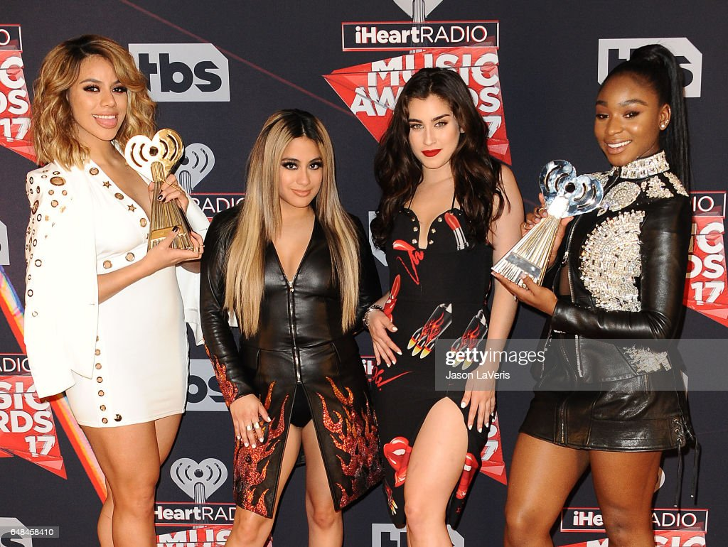 Singers Dinah Jane, Lauren Jauregui, Ally Brooke, and Normani Kordei of Fifth Harmony pose in the press room at the 2017 iHeartRadio Music Awards at The Forum on March 5, 2017 in Inglewood, California.