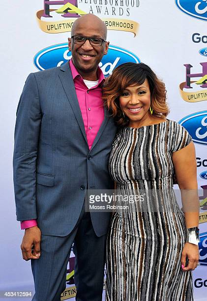 Singers Donnie McClurkin and Erica Campbell attends the 2014 Ford Neighborhood Awards Hosted By Steve Harvey at the Phillips Arena on August 9 2014...