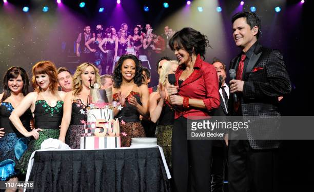 Singers Donny Osmond and Marie Osmond celebrate after being presented by their cast a cake at the conclusion of their 500th Donnie Marie variety show...