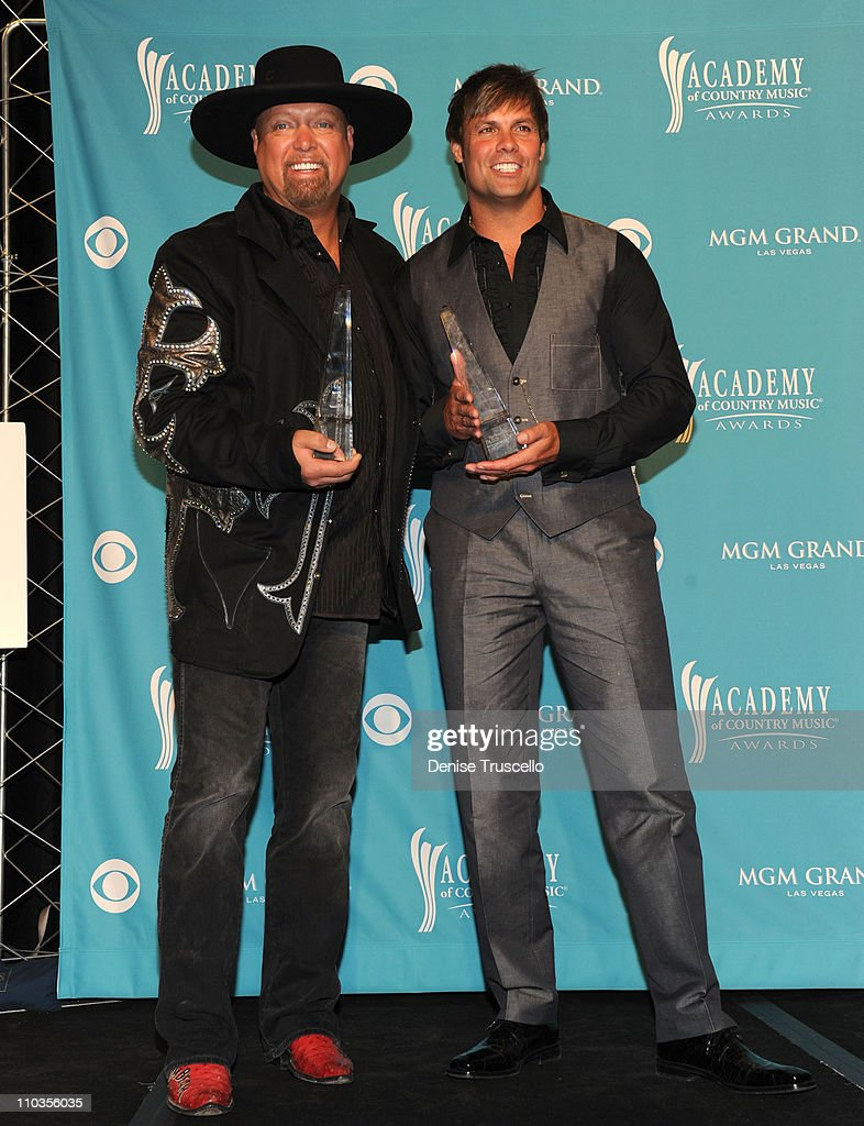 Singers Eddie Montgomery and Troy Gentry of Montgomery Gentry, recipients of the Home Depot Humanitarian Award poses in the press room during the 45th Annual Academy of Country Music Awards at the MGM Grand Garden Arena on April 18, 2010 in Las Vegas, Nevada.