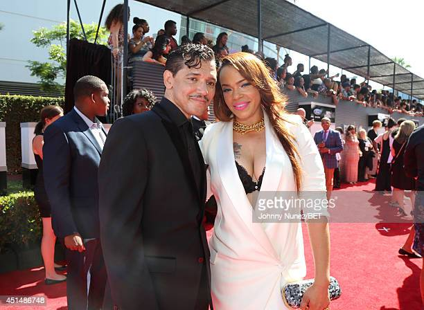 Singers El DeBarge and Faith Evans attend the BET AWARDS '14 at Nokia Theatre LA LIVE on June 29 2014 in Los Angeles California