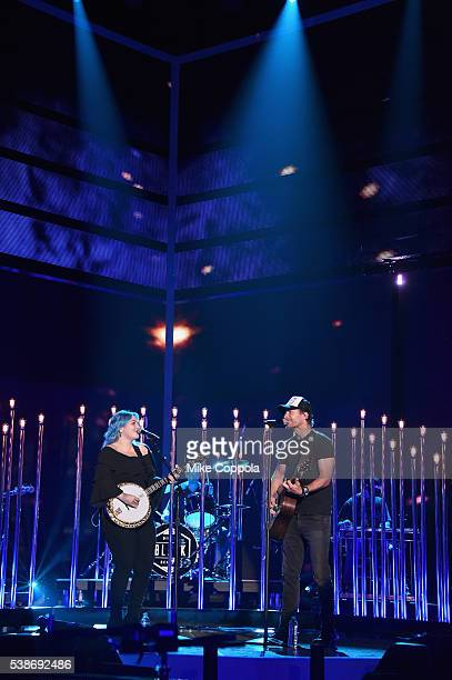 Singers Elle King and Dierks Bentley perform on stage during rehearsals at Bridgestone Arena on June 7 2016 in Nashville Tennessee